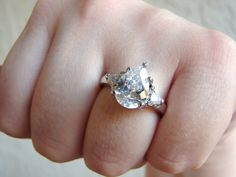 VIntage engagement style silver cocktail ring with tear drop crystal and side stones- size 8. $18.00, via Etsy.