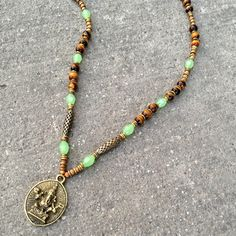 Tiger's eye for prosperity beaded Ganesha necklace #ganesha #lovepray #necklace #yoga #jewelry #green