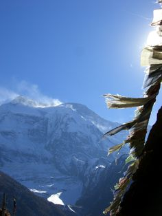 Prayer flags waving in front of magic mountains of Nepal