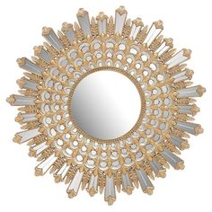 Add an ornate touch to your entryway or den with this chic wall mirror, showcasing a sunburst frame in silver and gold.   Product: ...