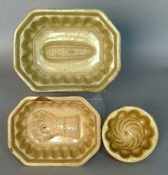 Three yelloware molds,
