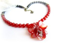 Carved flower carnelian stone pendant by MalinaCapricciosa on Etsy