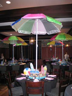 Summer beach themed centerpieces created by Lighter Than Air - www.ltaparty.com   #centerpiece #BlackstoneSteakhouse #beach #summer #umbrella #sand