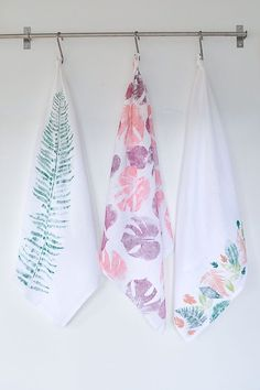 Create whatever look you want with this DIY leaf printed tea towel.   All you need is some paint and leaves!