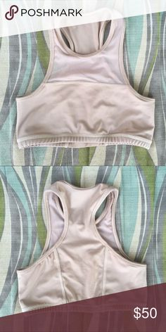 Nude High Neck Bikini Top/Sports Bra Size XS/S. Nude, high neck, racerback w/mesh paneling. It's actually a bikini top but I used it once as a sports bra.   10/10 condition. I've worn this once but I don't like the high neck style on me. No stains, no fading, no snags, no fuzzies.    $40 👉🏼 Ⓜ️ e r c acacia swimwear Swim Bikinis