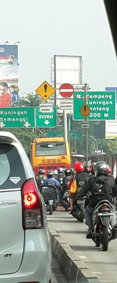 Motorcycles were following bus Transjakarta. Even though they should not be in the bus way, Jakarta ~Photo taken by Meidari Nawawi, 23 June 2014