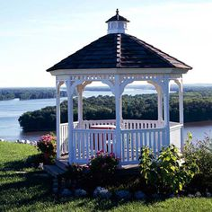 It's a match made in heaven--a beautiful white gazebo sits atop a bluff that overlooks water. The gazebo offers a great vantage point to watch the water. And it's also a beautiful focal point when viewed from a distance. The open framework, decorative trim, and small cupola are signature elements that define gazebos and make them instantly recognizable.
