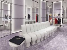 La Perla has opened its new flagship store in the Aoyama fashion district in Tokyo. Located in a building that has an irregular shape and was built entirely in glass, the store was entrusted to the Italian architectural studio, Baciocchi … Lingerie Store Design, Grey Roses, Love To Shop, Tokyo, Couch, Interior Design, Luxury, Rose Water, Collection