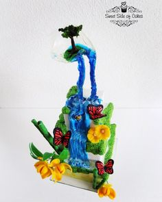 This is my contribution to the Acts of Green-UNSA 2016 collaboration. My inspiration came from my travels around the world and from the Water Cycle Song: Water travels. Unique Cakes, Creative Cakes, Water Cycle Song, Waterfall Cake, Butterfly Cakes, Flower Cakes, World Earth Day, Gravity Cake, Green Cake