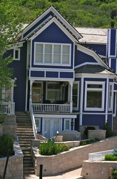 Navy blue cream exterior paint colours superior for Beach house siding ideas