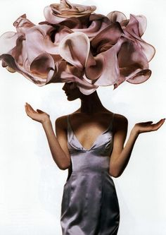 Shalom Harlow, 1995.    This is a way out there hat, but it is one of those pretty fantasy ideas. I would think this would be beautiful addition to a glamour shoot or to a tea room.
