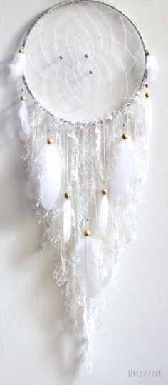 The White Arctic Fox Native Woven Dreamcatcher. $119.00, via Etsy.