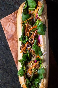 Banh Mi Fresh herbs, grilled chicken and crunchy vegetables come together for this sandwich.Fresh herbs, grilled chicken and crunchy vegetables come together for this sandwich. Vietnamese Recipes, Asian Recipes, Healthy Recipes, Ethnic Recipes, Vietnamese Food, Vietnamese Sandwich, Banh Mi Sandwich, Lemongrass Chicken Recipe, Banh Mi Chicken Recipe