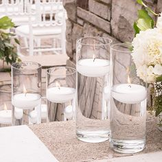 The Glass Cylinder can be combined to make an exciting centerpiece or a modern sand ceremony set. This glass cylinder can be made into beautiful luminaries by simply wrapping vellum around the outside or filled with flowers as a modern vase. Unique Wedding Centerpieces, Wedding Table Centerpieces, Wedding Reception Decorations, Floral Centerpieces, Unique Weddings, Wedding Ideas, Wedding Venues, Centerpiece Ideas, Wedding Favors