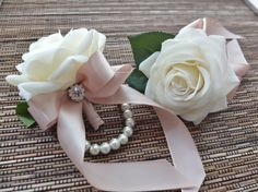 The listing is for ONE corsage. Elegant wrist corsage is made with real-touch white roses accented with rhinestone and champagne ribbon, finished on pearl bracelet. Perfect for any prom. The measures is approx. 8cm by 6 cm at its widest length. Ribbon color can be changed according