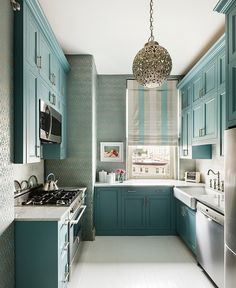 MHD is intrigued by the visually shallow depth of the upper cupboards; they must be recessed into the wall. We could use that on the breakfast end of our kitchen.