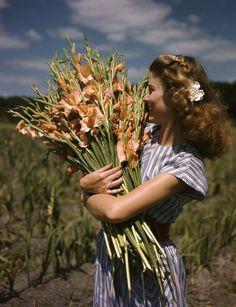 1. Unidentified woman holding gladiolus at Terra Ceia Island Farms