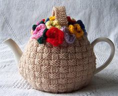 Cute tea cozy  I remember watching Mom make these for craft sales ... Years Ago