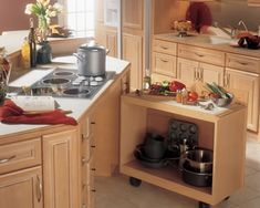 Roll-out carts or cabinets, particularly under cooktops and/or sinks, is a great option to ensure accessibility without losing storage. Image: GE Appliances
