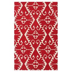 Hand-tufted wool rug in red with a damask motif. Made in India.  Product: RugConstruction Material: Wool