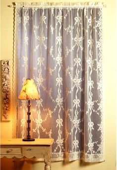 Lace Curtains: Cascade is available in finished curtains and yardage. This is a charming pattern with bows and flowers running vertically. Originally produced in 1900.