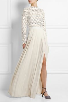 SELF-PORTRAIT Guipure lace and crepe maxi dress $640 | Self-Portrait's maxi dress is perfect for modern brides or evening events. It has a guipure lace bodice - lined with a nude bandeau - and a floor-length pleated skirt that moves beautifully. Emphasize the high thigh split with contrasting heels.
