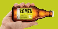 """Łomża Podkapslowe beer bottle packaging by Touch-Ideas / label encourages to rotate the bottle before drinking. It says: """"Are you holding this bottle horizontally? That's good."""
