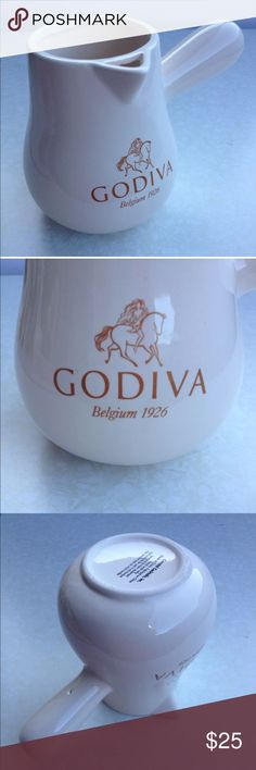 LADY GODIVA BELGIUM 1926 CERAMIC CHOCOLATE SERVING Welcome to My Store!  LOT 1 LADY GODIVA BELGIUM 1926 CERAMIC CHOCOLATE SERVING POUR MUG NUDE RIDER LOGO  GODIVA CHOCOLATIER HOT CHOCOLATE POT BY  COASTAL COCKTAILS, INC.   This cream pot has Nude Lady Godiva on a Horse logo  height is 5 & 1/4 inches  opening diameter is approx 3 inches  bottom diameter is 4 & 1/4 inches  Pre-Owned in Excellent Condition   These comes from a Smoke-Free & Pet-Free Environment.  Let me know if you have any…
