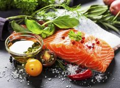 Delicious portion of fresh salmon fillet with aromatic herbs, spices and vegetables - healthy food, diet or cooking concept - stock photo Dieta Mind, Alain Delabos, Dieta Anti-inflamatória, Dieta Low, Clean Eating, Healthy Eating, Healthy Cooking, Stay Healthy, Healthy Hair