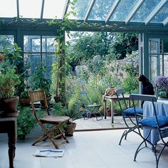 To have an English, wild garden like this and a sunroom that opens to the garden - this is divine!