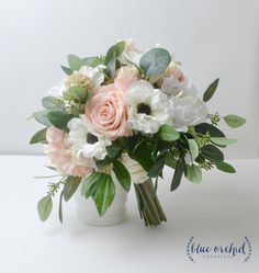 Each of our wedding bouquets is made with high quality, silk (artificial) flowers and elements. Our bridal bouquets are great wedding flowers for your big day (especially if you are planning a…More Wedding Flower Arrangements, Flower Bouquet Wedding, Floral Arrangements, Bridal Flowers, Bridal Bouquet Diy, Anemone Wedding, Beach Wedding Bouquets, Wedding Dresses, Cheap Wedding Flowers
