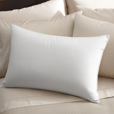Add comfort to your night sleep with the Famous Maker down alternative pillow. Featuring a 230 thread count, this pillow is made from a 50-percent cotton and 50-percent polyester cambric shell filled with hypoallergenic 100-percent polyester fill.