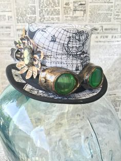 Available on etsy.com/shop/arcaniumdesign : Steampunk Mini Top Hat Fascinator - Map Print with Tiny Goggles and Embellishments