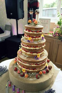 Our amazing strawberry naked 3 tier wedding cake with pez bride and groom toppers (Made by Eleanor Ogbourne-Webb) #strawberries #cream #nakedcake #wedding #pez
