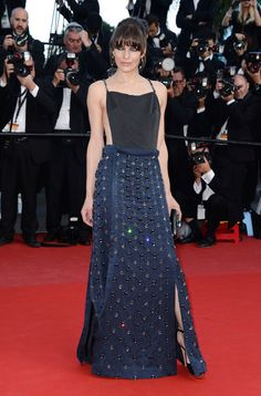 Cannes Stop, Wont Stop: All the Red Carpet Glamour (Updated!): Marion Cotillard gave the gowns a break, reaching for an embroidered Alexander McQueen Spring 2013 jumpsuit for a Crash Magazine party.  : Milla Jovovich stepped out in a slinky black-and-navy Prada gown at Cleopatras premiere.