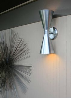 The Dual Scone Wall Sconce will add the finishing touches to any mid-century…