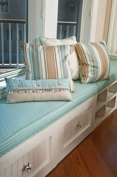 Love the starfish knobs on the drawers under this window seat!
