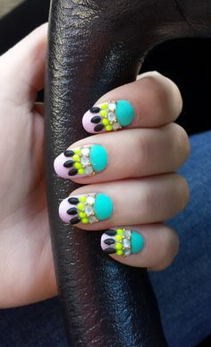 Pull out the bedazzler and go nail crazy! These are a fun take on the be-jeweled nail tend.