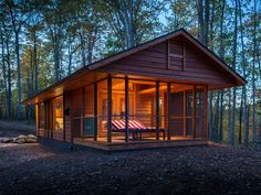 Inspired by and built by the team responsible for the gorgeous cottages at the Canoe Bay resort in the woods of Wisconsin, the 392-square-foot Escape looks like a high-end cabin but is actually a 28- by 14-foot Park Model RV on wheels. Vaulted ceilings and a large window wall give an airy feel to the cottage, which includes a living room with fireplace and kitchen wall and a separate bedroom and bath. Large French doors open to a screened porch that can be used as an extended living room…
