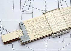 Slide rule. As a mechanical engineer he always had one close by.