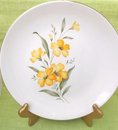 These are such pretty dinner plates! Made by International D.S. Co. from Alliance, Ohio. the pattern is called, Spring Gold. They feature sunny yellow flowers with green leaves and a gold border. What is so remarkable about these plates is what great condition they are in for their age. They are very reflective as you can see in the pictures. There are no chips, cracks or crazing, and only a very small amount of gold loss on the borders. The images of the flowers is perfect. Plates measure…