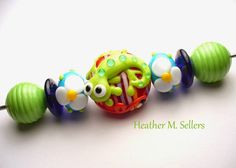 Izzy No.3 a lampwork glass bead lizard by Heather Sellers.
