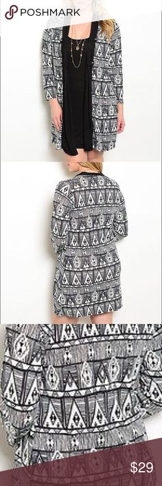 Black Tribal Geometric Dress w/ attached Cardigan Plus size 95% Polyester 5% Spandex.  Black Tribal Geometric Dress with attached Cardigan. Cap-sleeve. Bust measurements are 1X 21 inches across from armpit to armpit while laying flat. 2X 22 inches across from armpit to armpit while laying flat. 3X 23inches across from armpit to armpit while laying flat. Length is 36 inches. All measurements are approximate. Delirious Dresses Midi