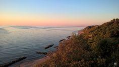 Sundown in Tisvildeleje July 2015. Coast of Sweden in the horizon