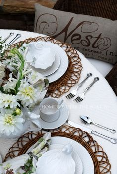 Avian accents on the dishes and rattan chargers make a lovely setting with a nod to nature and the bird's nest. ♥