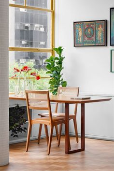 The space is characterised by stylised furniture pieces, including retro leather and wood armchairs designed by Vilanova Artigas and a sideboard suspended between two columns to give the impression that it's floating. Painted Window Frames, Dining Area, Dining Chairs, Condominium Interior, Green Velvet Sofa, Apartment Renovation, New Architecture, Wood Arm Chair, Parquet Flooring