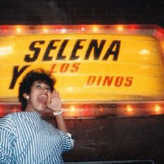 """Selena y Los Dinos in Lights Selena Y Los Dinos was the name of her family's band. They recorded their first album, """"Mis Primeras Grabaciones"""" in 1984, when Selena was only 13 years old. The photo below proves that she was ready for the stage!"""