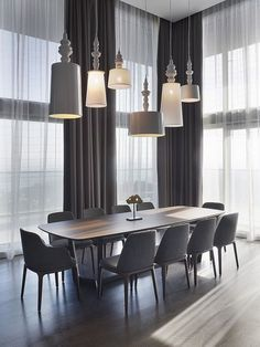 MODERN IDEAS FOR YOUR DINING ROOM |Great dining area, with amazing lamps.  the similar shape, but different sizes. | www.bocadolobo.com #diningroomdecorideas #moderndiningrooms