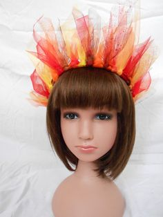 Whether youre a toddler, child, or adult, youll look smokin hot in this bold,crazy, and playful fire crown. Hand-cut tulle and organza flames