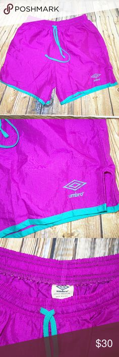 """Umbro Vintage Soccer Shorts Adult M Purple Vintage UMBRO soccer Shorts Adult M Purple Teal Classic b10 Preowned in great condition Classic soccer shorts Elastic and drawstring waist Waist is 30"""" unstretched Purple with teal trim No rips, tears or stains I have other items like this listed thank you for looking! Umbro Shorts Athletic"""